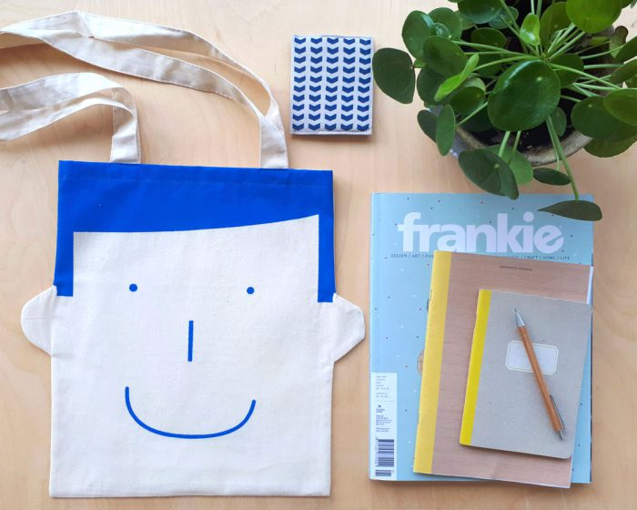 tote bag with face in blue